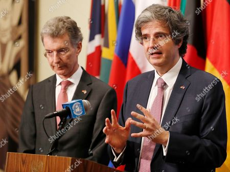 Christoph Heusgen, Francois Delattre. France's UN Ambassador Francois Delattre, right, gestures as he stands beside Germany's UN Ambassador Christoph Heusgen following their final Security Council meeting as co-presidents of the UN Security Council at the United Nations, in New York. Both men summarized what they felt were the key accomplishments of their term at the helm of the Security Council