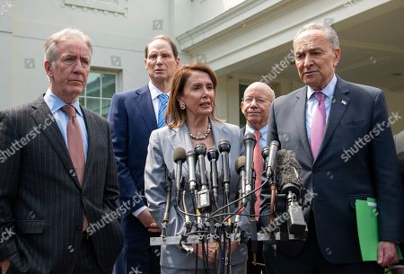 Speaker of the United States House of Representatives Nancy Pelosi (Democrat of California) makes a statement as she and Democratic members of the United States House and Senate speak to reporters Pictured from left to right: US Representative Richard Neal (Democrat of Massachusetts), US Senator Ron Wyden (Democrat of Oregon), Speaker Pelosi, US Representative Peter DeFazio (Democrat of Oregon), and US Senate Minority Leader Chuck Schumer (Democrat of New York).