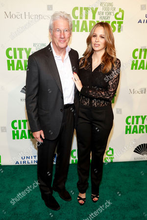 Richard Gere, Alejandra Silva. Richard Gere, left, and Alejandra Silva, right, attend City Harvest's 36th annual benefit gala at Cipriani 42nd Street, in New York