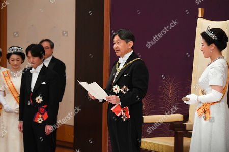 Japan's new Emperor Naruhito, accompanied by new Empress Masako, makes his first address during a ritual after succeeding his father Akihito at Imperial Palace in Tokyo, . Crown Prince and Crown Princess Akishino are seen at left