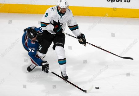 Gabriel Landeskog, Evander Kane, evander kane. Colorado Avalanche left wing Gabriel Landeskog, left, tries to push the puck away from San Jose Sharks left wing Evander Kane during the third period of Game 3 of an NHL hockey second-round playoff series, in Denver. The Sharks won 4-2