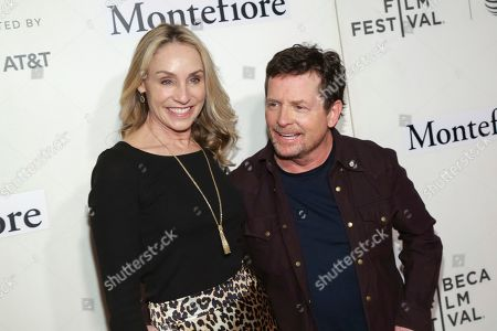 """Tracy Pollan, Michael J Fox. Actors Tracy Pollan, left, and Michael J Fox attend """"Tribeca Talks - StoryTellers: Michael J Fox with Denis Leary """" during the 2019 Tribeca Film Festival at the Tribeca Performing Arts Center, in New York"""
