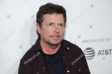 """Stock Image of Michael J Fox attends """"Tribeca Talks - StoryTellers: Michael J Fox with Denis Leary """" during the 2019 Tribeca Film Festival at the Tribeca Performing Arts Center, in New York"""