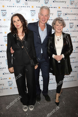 """Patty Smyth, John McEnroe, Bette Midler. Patty Smyth, from left, John McEnroe and Bette Midler attend the Natural Resources Defense Council's """"Night of Comedy"""" benefit at the New-York Historical Society, in New York"""