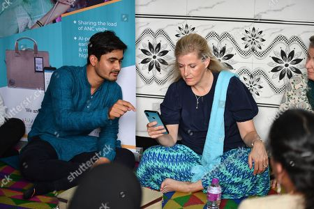 Sophie Countess of Wessex at the Padmanagar Apnalaya Health Clinic with Aditya Kulkarni Queens young Leader, Mumbai