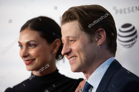 "Morena Baccarin, Benjamin McKenzie. Actors Morena Baccarin, left, and husband Benjamin McKenzie attend the screening for ""Framing John DeLorean"" during the 2019 Tribeca Film Festival at the SVA Theatre, in New York"