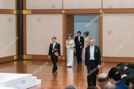 In this photo released by Imperial Household Agency of Japan, Japan's new Emperor Naruhito, left, followed by Empress Masako, Crown Prince Akishino and Crown Princess Akishino, arrives to make his first address during a ritual after succeeding his father Akihito at Imperial Palace in Tokyo