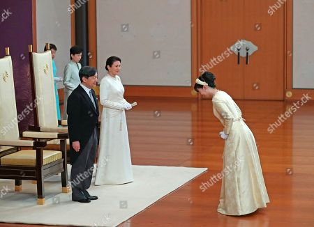 Princess Kako greets Japan's new Emperor Naruhito and new Empress Masako at the Imperial Palace in Tokyo . Emperor Naruhito inherited the sacred sword and jewel that signaled his succession and pledged in his first public address Wednesday to follow his father's example by devoting himself to peace and sharing the people's joys and sorrows