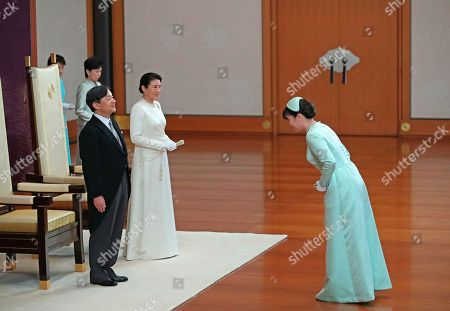 Princess Mako greets Japan's new Emperor Naruhito and new Empress Masako at the Imperial Palace in Tokyo . Emperor Naruhito inherited the sacred sword and jewel that signaled his succession and pledged in his first public address Wednesday to follow his father's example by devoting himself to peace and sharing the people's joys and sorrows