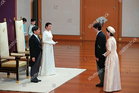 Crown Prince Akishino, second right, and Crown Princess Kiko, right, greet Japan's new Emperor Naruhito and new Empress Masako at the Imperial Palace in Tokyo . Emperor Naruhito inherited the sacred sword and jewel that signaled his succession and pledged in his first public address Wednesday to follow his father's example by devoting himself to peace and sharing the people's joys and sorrows