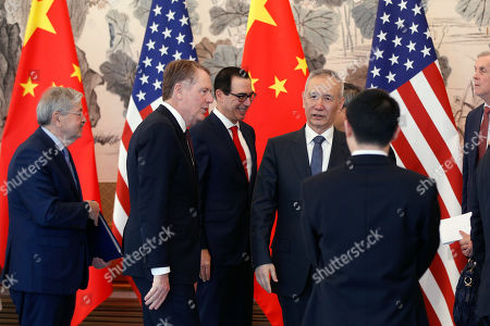 Stock Picture of Chinese Vice Premier Liu He (2-R) talks with US Treasury Secretary Steven Mnuchin (C), US Trade Representative Robert Lighthizer (2-L) and US Ambassador to China Terry Branstad (L) after concluding their meeting at the Diaoyutai State Guesthouse in Beijing, China, 01 May 2019.