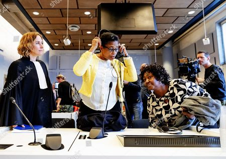 Esther Kiobel (C) and Victoria Bera (R) from Nigeria and their lawyer Channa Samkalden stand in court after the verdict in the trial of the Nigerian widows against Shell, in The Hague, the Netherlands, 01 May 2019. The two women accuse the oil company of human rights violations and involvement in the death of their spouses, who were hanged less than two weeks after the death sentence was pronounced. They believe that Shell bribed witnesses during a trial in the 90s.