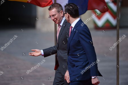 Polish prime minister Mateusz Morawiecki (R) and Latvian Foreign Minister Edgars Rinkevics (L) during the greeting ceremony in the courtyard of the Royal Castle in Warsaw's Old Town, Poland, 01 May 2019. The 'Together for Europe' EU enlargement 15th anniversary summit is hosted by Poland's PM Mateusz Morawiecki and is attended by officials of the ten countries that joined the EU in 2004, plus Romania, Bulgaria and Croatia.