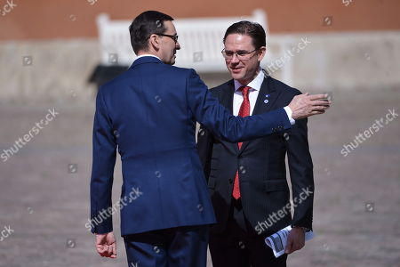 Polish prime minister Mateusz Morawiecki (L) and vice-President of the European Commission Jyrki Katainen (R) during the greeting ceremony in the courtyard of the Royal Castle in Warsaw's Old Town, Poland, 01 May 2019. The 'Together for Europe' EU enlargement 15th anniversary summit is hosted by Poland's PM Mateusz Morawiecki and is attended by officials of the ten countries that joined the EU in 2004, plus Romania, Bulgaria and Croatia.