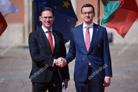 Polish prime minister Mateusz Morawiecki (R) and vice-President of the European Commission Jyrki Katainen (L) during the greeting ceremony in the courtyard of the Royal Castle in Warsaw's Old Town, Poland, 01 May 2019. The 'Together for Europe' EU enlargement 15th anniversary summit is hosted by Poland's PM Mateusz Morawiecki and is attended by officials of the ten countries that joined the EU in 2004, plus Romania, Bulgaria and Croatia.