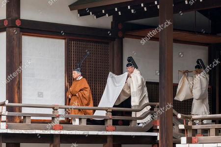 In this photo provided by the Imperial Household Agency of Japan, Japan's Emperor Akihito, left, walks for a ritual to report his abdication to the throne, at the Imperial Palace in Tokyo, . The 85-year-old Akihito ends his three-decade reign on Tuesday when he abdicates to his son Crown Prince Naruhito
