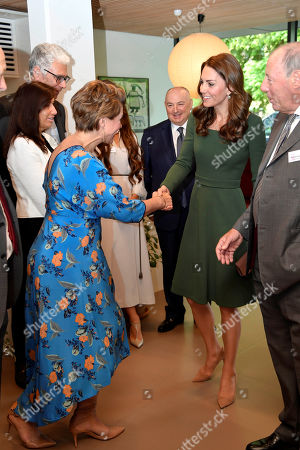 Catherine Duchess of Cambridge shakes hands with journalist Kate Silverton during her visit at the Anna Freud National Centre for Children and Families in London