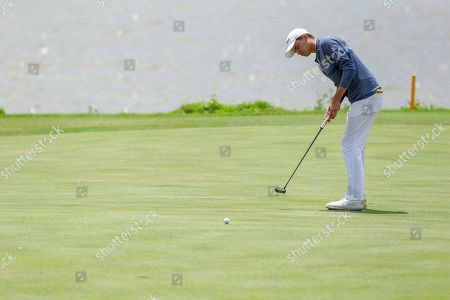Virgina's David Morgan makes this putt for birdie on the seventeenth green during the Atlantic Coast Conference Championship golf tournament, in New London, N.C