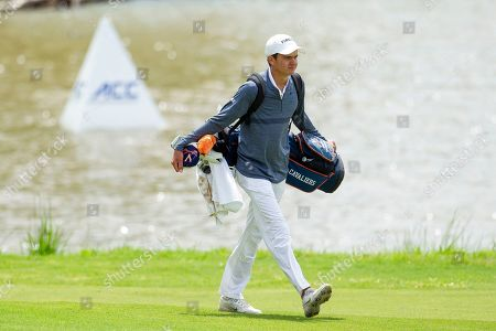 Stock Image of Virginia's David Morgan walks up to the seventeenth green during the Atlantic Coast Conference Championship golf tournament, in New London, N.C