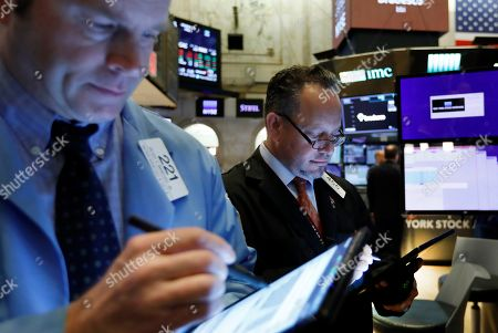 Peter Mancuso, Robert Arciero. Traders Peter Mancuso, left, and Robert Arciero work on the floor of the New York Stock Exchange, . Stocks are opening higher on Wall Street after several big U.S. companies reported earnings that were better than analysts were expecting