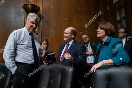 Sheldon Whitehouse, Chris Coons, Amy Klobuchar. Democratic members of the Senate Judiciary Committee, from left, Sen. Sheldon Whitehouse, D-R.I., Sen. Chris Coons, D-Del., and Sen. Amy Klobuchar, D-Minn., confer after questioning Attorney General William Barr about special counsel Robert Mueller's Russia report, on Capitol Hill in Washington