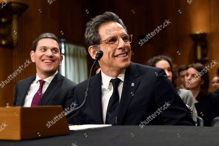 Ben Stiller, David Miliband. Actor Ben Stiller, front right, and David Miliband, left, the former British foreign secretary who now leads the International Rescue Committee (IRC), sits down to testify before the Senate Foreign Relations Committee on Capitol Hill in Washington, during a hearing on the humanitarian Impact of 8 years of war in Syria