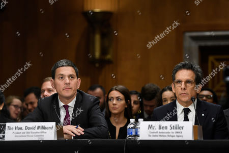 Ben Stiller, David Miliband. David Miliband, left, the former British foreign secretary who now leads the International Rescue Committee (IRC), and actor Ben Stiller, right, sit down to testify before the Senate Foreign Relations Committee on Capitol Hill in Washington, during a hearing on the humanitarian impact of 8 years of war in Syria
