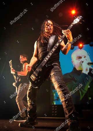 John Moyer, Dan Donegan and David Draiman of the band 'Disturbed' live on stage.