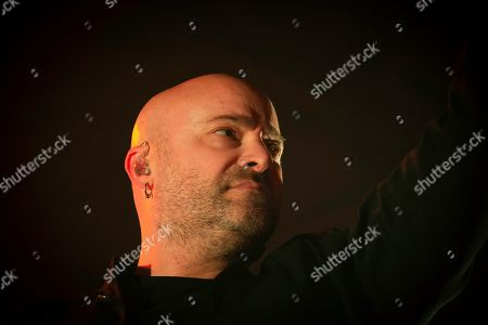 David Draiman of the band 'Disturbed' live on stage.