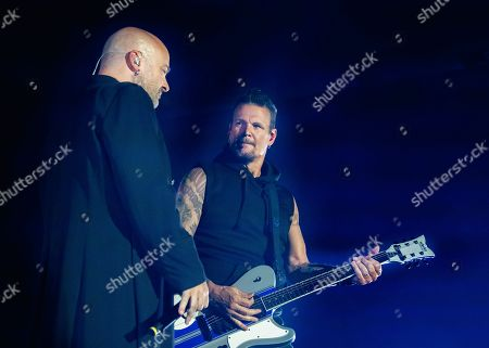 Dan Donegan and David Draiman of the band 'Disturbed' live on stage.