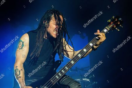 John Moyer of the band 'Disturbed' live on stage.