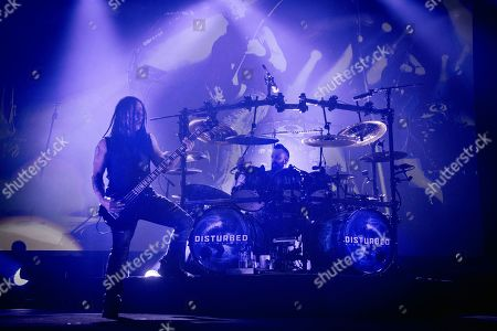 John Moyer and Mike Wengren of the band 'Disturbed' live on stage.