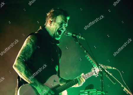 Stock Photo of Dan Donegan of the band 'Disturbed' live on stage.