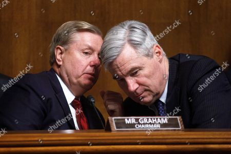 Senator Lindsey Graham (R-S.C.) whispers with Senator Sheldon Whitehouse (D-R.I.) as US Attorney General William Barr testifies before the Senate Judiciary Committee's hearing on 'The Justice Department's Investigation of Russian Interference with the 2016 Presidential Election' on Capitol Hill in Washington, DC, 01 May 2019. Attorney General Barr is facing questions from Senators for the first time since the release of special counsel Robert Mueller's Russia report on 18 April 2019.