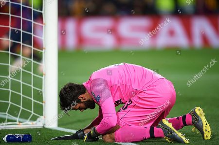 Alison Becker of Liverpool FC reacts after receiving the 3-0