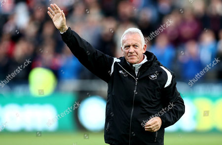 Alan Curtis waves to the crowd as he prepares to leave the club after 40 year association with them.