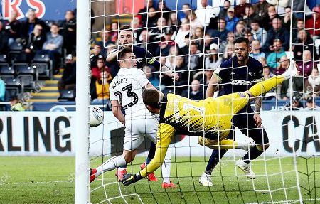 Stock Image of Kristoffer Nordfeldt of Swansea City makes a save from Scott Malone of Derby County.
