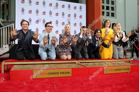"""Johnny Galecki, Jim Parsons, Kaley Cuoco, Simon Helberg, Kunal Nayyar, Mayim Bialik, Melissa Rauch. Johnny Galecki, from left, Jim Parsons, Kaley Cuoco, Simon Helberg, Kunal Nayyar, Mayim Bialik and Melissa Rauch members of the cast of the TV series """"The Big Bang Theory,"""" show their hands after placing them in cement during a hand and footprint ceremony at the TCL Chinese Theatre on at in Los Angeles"""