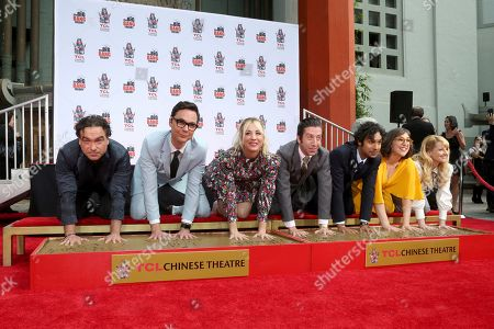 """Johnny Galecki, Jim Parsons, Kaley Cuoco, Simon Helberg, Kunal Nayyar, Mayim Bialik, Melissa Rauch. Johnny Galecki, from left, Jim Parsons, Kaley Cuoco, Simon Helberg, Kunal Nayyar, Mayim Bialik and Melissa Rauch, members of the cast of the TV series """"The Big Bang Theory,"""" place their hands in cement during a hand and footprint ceremony at the TCL Chinese Theatre on at in Los Angeles"""