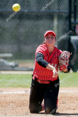 Stock Photo of Lamar third base player Taylor Murphy fields an infield bunt to first for the out against Nicholls State during an NCAA softball game on in Beaumont, Texas