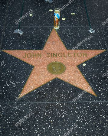 A candle placed to honor the memory of late US director John Singleton