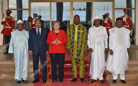 German Chancellor Angela Merkel (3-L) stands next to Burkina Faso President Roch Marc Christian Kabore (3-R), President of Mali Ibrahim Boubacar Keita (L), President of Mauritania Mohamed Ould Abdel Aziz (2-L), President of Niger Mahamadou Issoufou (R), and President of Chad Idriss Deby (2-R) at the meeting of the regional organisation G5 Sahel in Ouagadougou, Burkina Faso, 01 May 2019. Chancellor Merkel is on an official tour of West African nations Burkina Faso, Mali, and Niger.