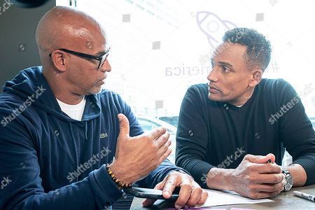 Grosse Pointe Park resident Matt Evans, 48, (left) speaks with actor, author, and owner of The Roasting Plant, Hill Harper (right) about the importance of financial literacy and how Experian Boost can assist with improving credit scores at the Roasting Plant at the #BoostAmerica campaign launch on in Detroit