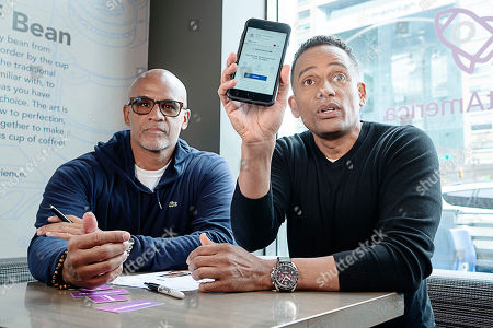 Grosse Pointe Park resident Matt Evans, 48, (left) speaks with actor, author, and owner of The Roasting Plant, Hill Harper (right) about the importance of financial literacy and how Experian Boost can assist with improving credit scores at the Roasting Plant in Detroit at the #BoostAmerica campaign launch on in Detroit