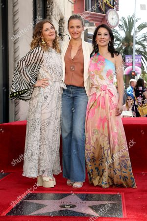 """Drew Barrymore, Cameron Diaz, Lucy Liu. Drew Barrymore, from left, Cameron Diaz and Lucy Liu, cast members of the film, """"Charlie's Angels"""" pose atop a star at a ceremony honoring Liu with a star on the Hollywood Walk of Fame, in Los Angeles"""