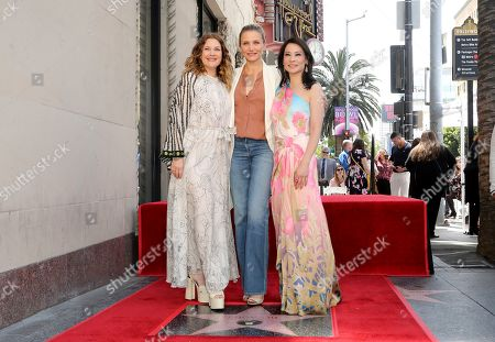 """Drew Barrymore, Cameron Diaz, Lucy Liu. Drew Barrymore, from left, Cameron Diaz and Lucy Liu, cast members of the film, """"Charlie's Angels"""" pose a ceremony honoring Liu with a star on the Hollywood Walk of Fame, in Los Angeles"""