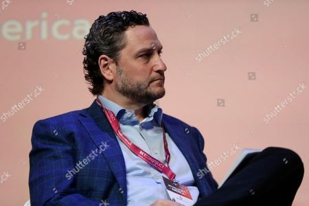 Stock Photo of Adam Rosenberg, managing director and global head of gaming and leisure for the Fortress Investment Group, moderates a panel discussion during the Betting On Sports America conference, in Secaucus, N.J