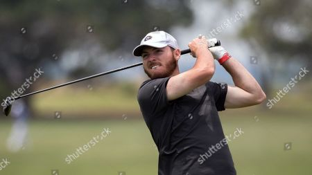 Georgia's Trevor Phillips watches his drive off the 16th tee during the SEC golf tournament, in St. Simons Island, Ga