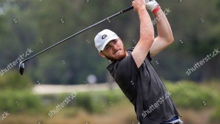 Stock Photo of Georgia's Trevor Phillips watches his drive off the 13th tee during the SEC golf tournament, in St. Simons Island, Ga