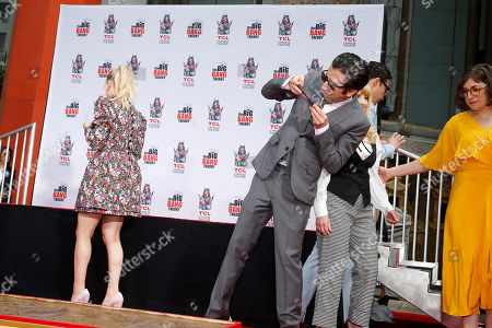 Simon Helberg takes a photo of his signature and handprints at the TCL Chinese Theatre IMAX in Hollywood, California, USA, 01 May 2019. ' The Big Bang Theory' is the longest - running multi- camera comedy series in television history.
